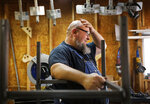 Jack Lyons, a contractor working on massive rocket test stands for NASA, stands in his workshop while spending the furlough on his small side business making props for marching bands, in Madison, Ala., Tuesday, Jan. 8, 2019.