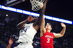 Penn State's Mike Watkins (24) scores on Cornell's Jimmy Boeheim (3) during first half action of an NCAA college basketball game, Sunday, Dec. 29, 2019, in State College, Pa. (AP Photo/Gary M. Baranec)