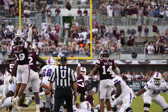 Louisiana Tech place kicker Caleb Phillips, center, watches as his field goal fails against Mississippi State with only seconds on the clock during the fourth quarter of an NCAA college football game in Starkville, Miss., Saturday, Sept. 4, 2021. Mississippi State won 35-34. (AP Photo/Rogelio V. Solis)
