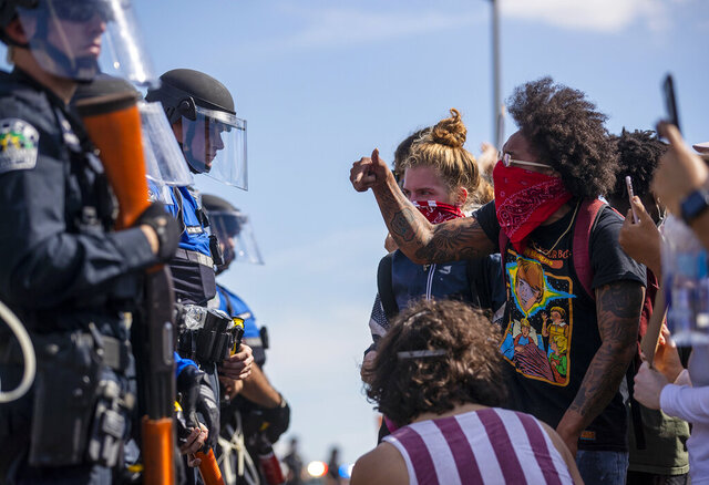 Protesters confront Austin Police officers on the southbound lane of Interstate 35, Saturday, May 30, 2020, in Austin, Texas, during demonstrations in response to the Memorial Day death of George Floyd while in police custody in Minneapolis. (Ricardo B. Brazziell/Austin American-Statesman via AP)
