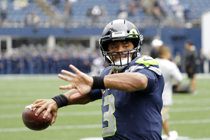 Seattle Seahawks quarterback Russell Wilson warms up before an NFL football game against the New Orleans Saints, Sunday, Sept. 22, 2019, in Seattle. (AP Photo/Ted S. Warren)