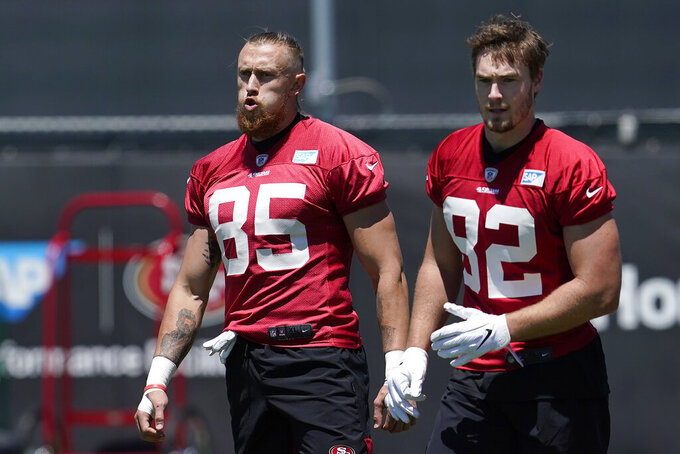 San Francisco 49ers tight ends George Kittle (85) and Ross Dwelley (82) work out at the team's NFL football training facility in Santa Clara, Calif., Tuesday, May 25, 2021. (AP Photo/Jeff Chiu)