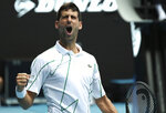 Serbia's Novak Djokovic celebrates a point win against Japan's Tatsuma Ito during their second round singles match at the Australian Open tennis championship in Melbourne, Australia, Wednesday, Jan. 22, 2020. (AP Photo/Dita Alangkara)