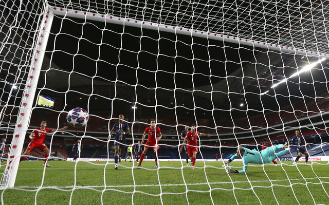 PSG's goalkeeper Keylor Navas fails to make a save on a shot taken by Bayern's Kingsley Coman, 2nd right, during the Champions League final soccer match between Paris Saint-Germain and Bayern Munich at the Luz stadium in Lisbon, Portugal, Sunday, Aug. 23, 2020. (Miguel A. Lopes/Pool via AP)