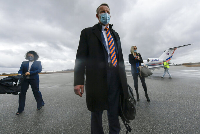 In this photo provided by Auburn Athletics, Bryan Harsin, Auburn's new college football coach, talks to fans after his arrival at an airport Thursday, Dec. 24, 2020, in Auburn, Ala. (Todd Van Emst/Auburn Athletics via AP)