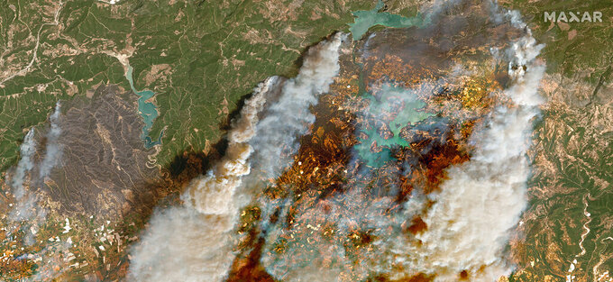 In this image provided by Maxar, a satellite view of smoke rising from wildfires near Oymapinar Dam, southern Turkey, on Thursday July 29, 2021.  Turkish fire crews are continuing to fight deadly blazes in southern Turkey that have burned down homes and forced many evacuations. (Satellite image ©2021 Maxar Technologies via AP)