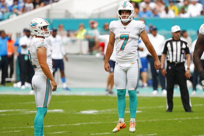Miami Dolphins kicker Jason Sanders (7) jumps in frustration after missing a field goal, during the first half at an NFL football game against the Los Angeles Chargers, Sunday, Sept. 29, 2019, in Miami Gardens, Fla. To the left is Mpunter Matt Haack (2). AP Photo/Wilfredo Lee)