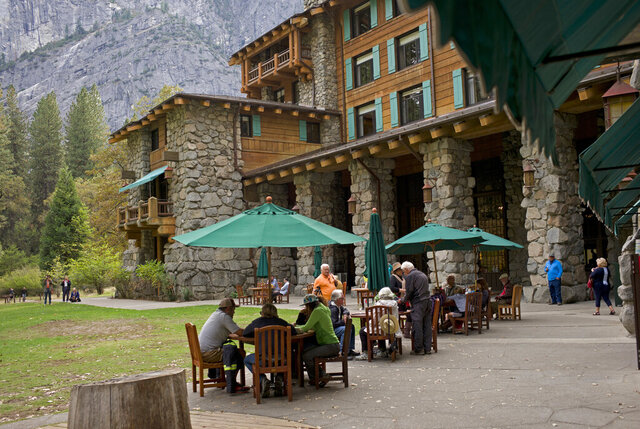 FILE - In this Oct. 24, 2015, file photo, people dine outside the Ahwahnee hotel in Yosemite National Park, Calif. Yosemite National Park is investigating about 170 reports of gastrointestinal illnesses and has confirmed two cases of norovirus, officials said Thursday, Jan. 16, 2020. The National Park Service began investigating after visitors and employees started reporting illnesses this month. (AP Photo/Ben Margot, File)