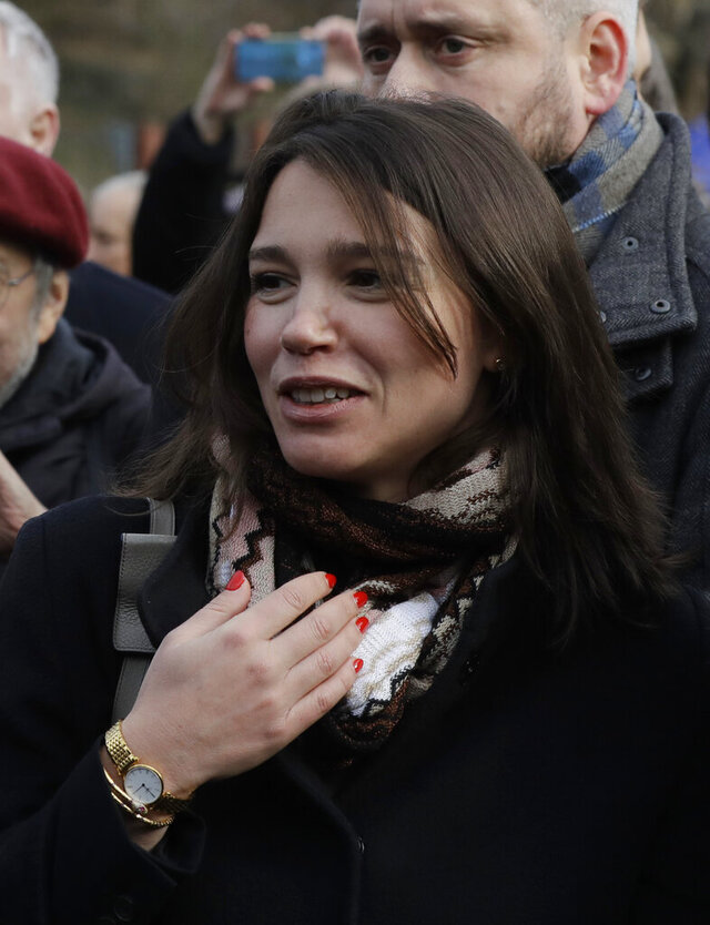 Zhanna Nemtsova, the daughter of Russian opposition figure Boris Nemtsov smiles during a ceremony of unveiling a sign renaming the square where the Russian embassy is located in Prague, Czech Republic, Thursday Feb. 27, 2020, named after the late Russian opposition leader Boris Nemtsov. Nemtsov was gunned down outside the Kremlin 5 years ago. (AP Photo/Petr David Josek)