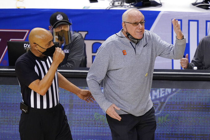 Syracuse head coach Jim Boeheim, right, reacts to a call during the first half of an NCAA college basketball game against North Carolina State in the second round of the Atlantic Coast Conference tournament in Greensboro, N.C., Wednesday, March 10, 2021. (AP Photo/Gerry Broome)