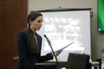 Former gymnast Rachael Denhollander gives her victim impact statement during the seventh day of Larry Nassar's sentencing hearing Wednesday, Jan. 24, 2018, in Lansing, Mich. Nassar has admitted sexually assaulting athletes when he was employed by Michigan State University and USA Gymnastics, which is the sport's national governing organization and trains Olympians. (AP Photo/Carlos Osorio)