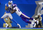 Detroit Lions wide receiver Marvin Jones (11) catches a 3-yard touchdown pass over Minnesota Vikings cornerback Xavier Rhodes (29) in the second quarter of an NFL football game, Sunday, Oct. 20, 2019, in Detroit. (Jerry Holt/Star Tribune via AP)
