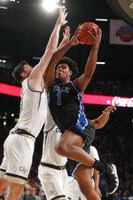 Duke center Vernon Carey Jr. (1) goes up for a basket as Georgia Tech forward Evan Cole (3) in the first half of an NCAA college basketball game Wednesday, Jan. 8, 2020, in Atlanta. (AP Photo/John Bazemore)