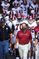 FILE - In this Sept. 26, 2020, file photo, Alabama coach Nick Saban leads his team to the field before an NCAA college football game against Missouri in Columbia, Mo. New Mississippi coach Lane Kiffin faces his old boss, Nick Saban, when the Rebels host No. 2 Alabama on Saturday. Saban last week improved to 20-0 when facing teams led by one of his former assistants. By(AP Photo/L.G. Patterson, File)