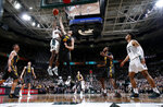 Michigan State's Aaron Henry, top left, goes up for a shot against Iowa's Ryan Kriener (15) during the second half of an NCAA college basketball game, Tuesday, Feb. 25, 2020, in East Lansing, Mich. Michigan State won 78-70. (AP Photo/Al Goldis)