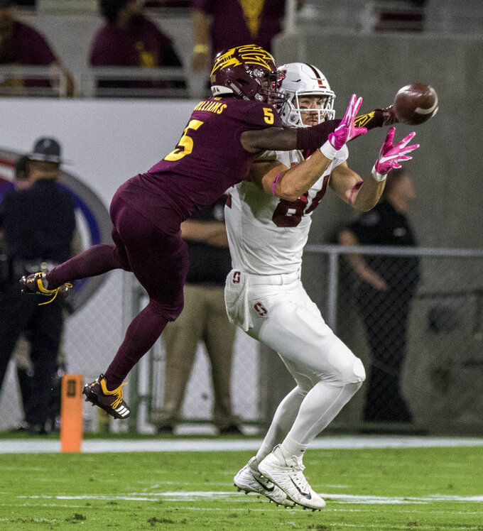Arizona State's Kobe Williams (5) deflects the ball intended for Stanford's Colby Parkinson (84) during the first half of an NCAA college football game Thursday, Oct. 18, 2018, in Tempe, Ariz. (AP Photo/Darryl Webb)
