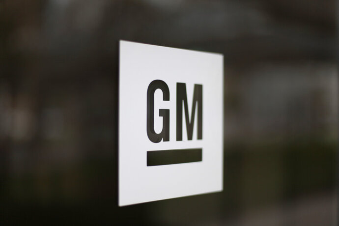 FILE - This May 16, 2014, file photo, shows the General Motors logo at the company's world headquarters in Detroit. General Motors is suing Fiat Chrysler, alleging that its crosstown rival got an unfair business advantage by bribing officials of the United Auto Workers union. The lawsuit, filed Wednesday, Nov. 20, 2019,  in U.S. District Court in Detroit, alleges that FCA was involved in racketeering by paying millions in bribes to get concessions and gain advantages in three labor agreements with the union. (AP Photo/Paul Sancya, File)