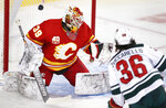 Minnesota Wild right wing Mats Zuccarello (36) scores against Calgary Flames goaltender Cam Talbot (39) during the second period of an NHL hockey game Thursday, Jan. 9, 2020, in Calgary, Alberta. (Larry MacDougal/The Canadian Press via AP)