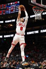 Chicago Bulls guard Zach LaVine (8) scores against the Atlanta Hawks in the first half of an NBA basketball game Wednesday, Nov. 6, 2019, in Atlanta. (AP Photo/John Bazemore)