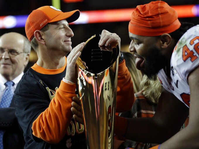Clemson head coach Dabo Swinney reacts with the trophy after the NCAA college football playoff championship game against Alabama, Monday, Jan. 7, 2019, in Santa Clara, Calif. Clemson beat Alabama 44-16. (AP Photo/David J. Phillip)