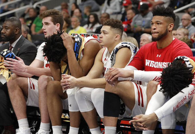 Wisconsin players react on the bench during the second half against Oregon in a first-round game of the NCAA men's college basketball tournament Friday, March 22, 2019, in San Jose, Calif. (AP Photo/Chris Carlson)