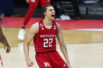 Rutgers guard Caleb McConnell (22) reacts to a basket against Clemson during the second half of a men's college basketball game in the first round of the NCAA tournament at Bankers Life Fieldhouse in Indianapolis, Friday, March 19, 2021. (AP Photo/Paul Sancya)