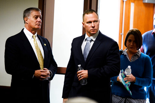 FILE - In this Oct. 24, 2019, file photo, suspended Greenville Sheriff Will Lewis, center, enters the courtroom with his wife, Amy, in Greenville, S.C. The former sheriff in South Carolina reported to prison Wednesday, Oct. 13, 2021, to serve a one-year sentence for using his power and office to pressure a personal assistant to have sex with him. The South Carolina Supreme Court refused to reconsider its August decision upholding ex-Greenville County Sheriff Will Lewis' 2019 conviction meaning Lewis ran out of appeals. (Josh Morgan/The Greenville News via AP, Pool, File)
