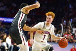Arizona guard Nico Mannion (1) is defended by Washington State forward Tony Miller during the second half of an NCAA college basketball game Thursday, March 5, 2020, in Tucson, Ariz. Arizona won 83-62. (AP Photo/Rick Scuteri)