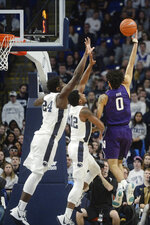 Penn State's Mike Watkins (24) and Izaiah Brockington (12) attempt to block a shot by Northwestern's Boo Buie (0) during the first half of an NCAA college basketball game, Saturday, Feb. 15, 2020, in State College, Pa. (AP Photo/Gary M. Baranec)