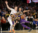 Los Angeles Lakers' LeBron James, right, pushes past New York Knicks' Mario Hezonja during the second half of the NBA basketball game, Sunday, March 17, 2019, in New York. The Knicks defeated the Lakers 124-123. (AP Photo/Seth Wenig)