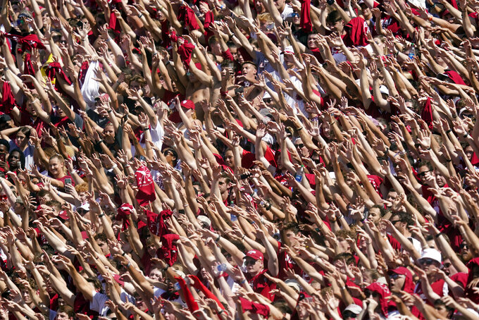 Indiana students cheer at the start of an NCAA college football game between Indiana and Cincinnati, Saturday, Sept. 18, 2021, in Bloomington, Ind. (AP Photo/Darron Cummings)