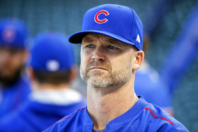 FILE - In this Oct. 14, 2016, file photo, Chicago Cubs' David Ross waits for his turn during batting practice before baseball's National League Championship Series against the Los Angeles Dodgers in Chicago.  The Chicago Cubs have hired former catcher David Ross to replace Joe Maddon as their manager, hoping he can help them get back to the playoffs after missing out for the first since 2014. (AP Photo/Charles Rex Arbogast, File)