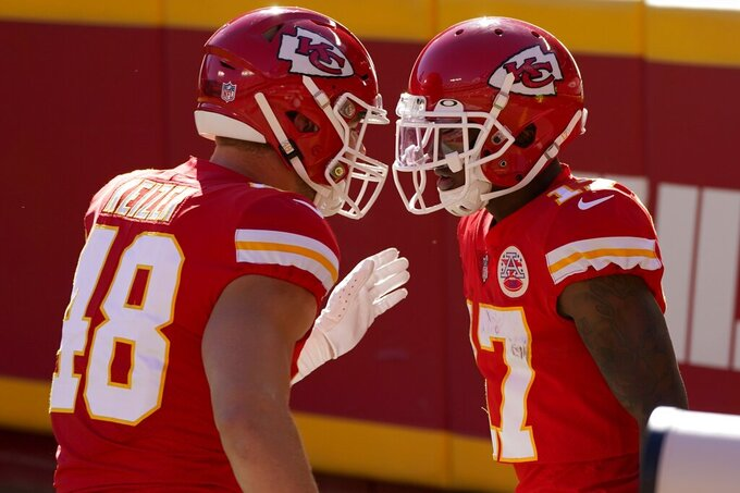 Kansas City Chiefs' Nick Keizer (48) and Mecole Hardman, right, celebrate a touchdown scored by Hardman in the first half of an NFL football game against the New York Jets on Sunday, Nov. 1, 2020, in Kansas City, Mo. (AP Photo/Charlie Riedel)