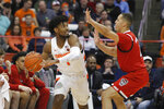 Syracuse's Quincy Guerrier, left, tries to pass around North Carolina State's Jericole Hellems, right, in the first half of an NCAA college basketball game in Syracuse, N.Y., Tuesday, Feb. 11, 2020. (AP Photo/Nick Lisi)