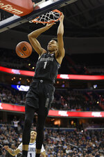 Georgetown guard Jamorko Pickett dunks during the second half of an NCAA college basketball game, Wednesday, Feb. 20, 2019, in Washington. Georgetown won 85-73. (AP Photo/Nick Wass)