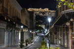 This photo shows a view of an empty street with the hill of the Acropolis at the background in Athens, Greece, Sunday, Oct. 25, 2020. Greece's government has imposed a nightly curfew in greater Athens and other areas with high infection rates as well as a mask requirement. (AP Photo/Yorgos Karahalis)