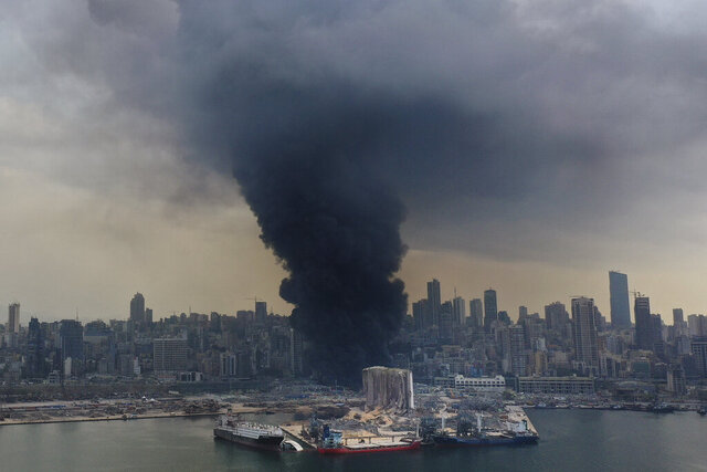 Black smoke rises from a fire at warehouses at the seaport of Beirut, Lebanon, Thursday, Sept. 10. 2020. A huge fire broke out Thursday at the Port of Beirut, triggering panic among residents traumatized by last month's massive explosion that killed and injured thousands of people. (AP Photo/Hussein Malla)