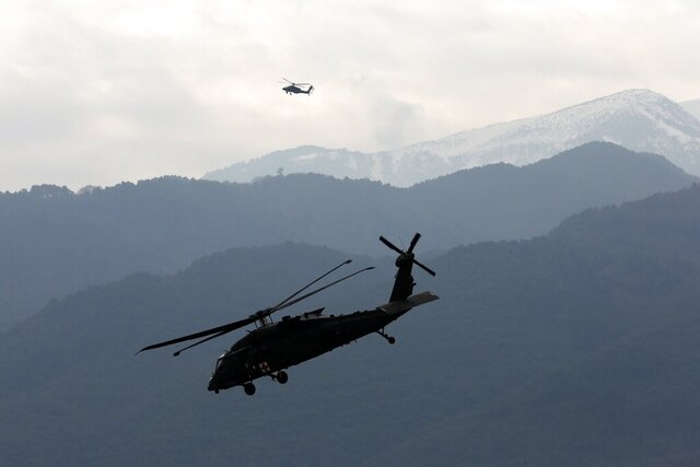 Helicopters take part in a military drill in Litochoro, northern Greece, on Wednesday, Feb. 19, 2020. Army aviation forces from Greece and the United States are taking part in a live-fire exercise with attack helicopters, marking deepening defense ties between the two countries. (AP Photo/Yorgos Karahalis)