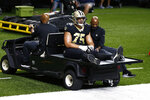 New Orleans Saints offensive guard Andrus Peat (75) is carted off the field after being injured in the first half of an NFL football game against the Green Bay Packers in New Orleans, Sunday, Sept. 27, 2020. (AP Photo/Butch Dill)