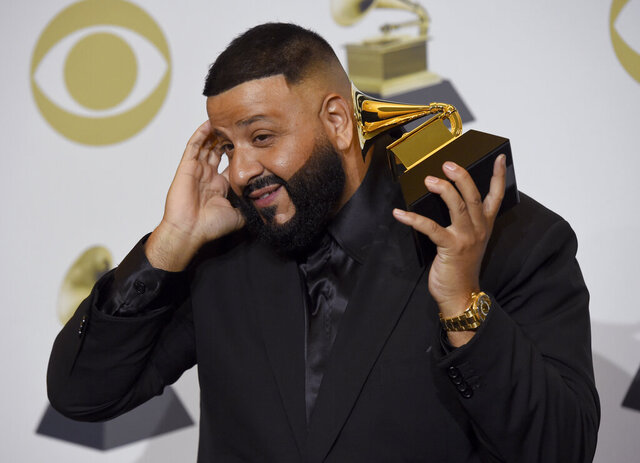 DJ Khaled poses in the press room with the award for best rap/sung performance for