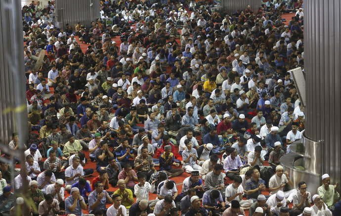 In this Feb. 14, 2020, photo, people gather during Friday prays at the Istiqlal Mosque in Jakarta, Indonesia. Indonesia, the world's largest Muslim-majority country, has not had a case of infection of a deadly viral outbreak that started in China and residents walk about and pray in groups five times a day in mosques without masks. The outbreak has infected more than ten of thousands of people worldwide and killed more than 1,000 where the new coronavirus strain was first detected in December. (AP Photo/Achmad Ibrahim)