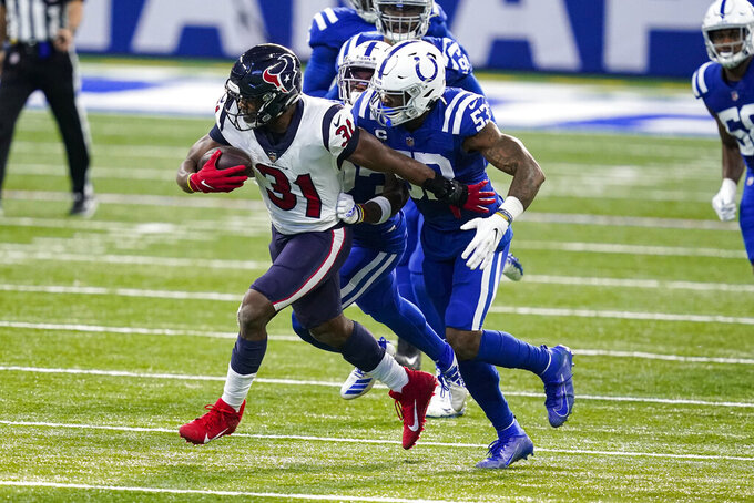 Houston Texans running back David Johnson (31) tries to get past Indianapolis Colts outside linebacker Darius Leonard (53) in the second half of an NFL football game in Indianapolis, Sunday, Dec. 20, 2020. (AP Photo/Darron Cummings)