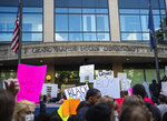 People gather in front of the Grand Rapids Police Department in downtown Grand Rapids, Mich., Saturday, May 30, 2020, to protest police brutality in the United States. (Anntaninna Biondo/The Grand Rapids Press via AP)