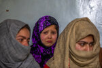 """Tears roll down the cheeks of 7 year old Mahira Nazir, cousin of 16-year-old Athar Mushtaq, as the family talks to Associated Press in Bellow, south of Srinagar, Indian controlled Kashmir, Tuesday, Jan. 5, 2021. On the last week of 2020, Indian government forces killed Athar and two other young men during a controversial gunfight on the outskirts of the Indian-controlled Kashmir's main city. Police did not call them anti-India militants but """"hardcore associates of terrorists."""