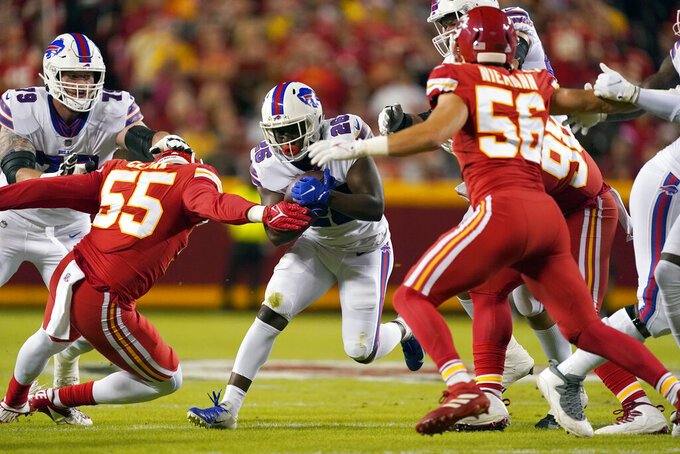 Buffalo Bills running back Devin Singletary (26) runs with the ball during the first half of an NFL football game against the Kansas City Chiefs Sunday, Oct. 10, 2021, in Kansas City, Mo. (AP Photo/Charlie Riedel)
