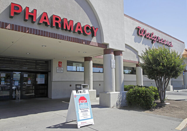 FILE - In this June 3, 2020, file photo, a sign alerts customers to a closed Walgreens pharmacy store following an overnight shooting in Vallejo, Calif. California's attorney general on Wednesday, June 24, 2020, is declining to independently investigate the fatal shooting of a man police say they thought was carrying a handgun in his waistband. He actually had a hammer. Sean Monterrosa was suspected of stealing from the San Francisco Bay Area pharmacy amid national protests when he was killed June 2. (AP Photo/Ben Margot, File)