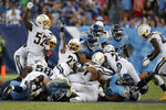 Los Angeles Chargers defenders celebrate after stopping the Tennessee Titans on a fourth-down play late in the fourth quarter of an NFL football game Sunday, Oct. 20, 2019, in Nashville, Tenn. (AP Photo/James Kenney)