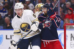 Buffalo Sabres defenseman Rasmus Ristolainen (55) and Columbus Blue Jackets forward Nick Foligno (71) battle in front of the net during the second period of an NHL hockey game Thursday, Feb. 13, 2020, in Buffalo, N.Y. (AP Photo/Jeffrey T. Barnes)