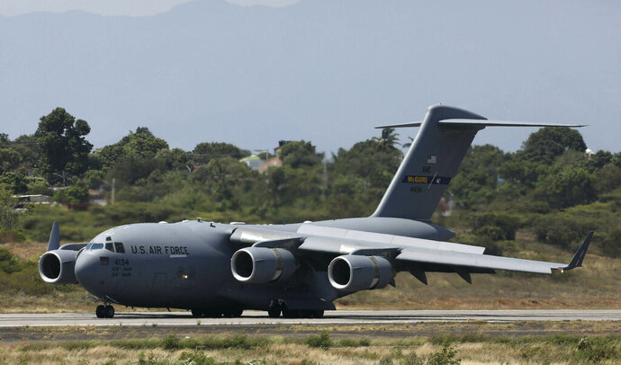 An United States Air Force C-17 cargo plane loaded with humanitarian aid lands at Camilo Daza airport in Cucuta, Colombia, Saturday, Feb. 16, 2019. The U.S. Air Force has begun flying tons of aid to the Colombian town on the Venezuelan border as part of an effort meant to undermine socialist President Nicolas Maduro. (AP Photo/Fernando Vergara)