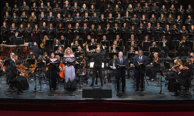 This photo provided by The Metropolitan Opera shows a rehearsal  for Verdi Requiem on Thursday, Sept. 9, 2021 at The Metropolitan Opera in New York.  Before a masked crowd of 3,600, music director Yannick Nézet-Séguin led a performance of the Verdi Requiem in commemoration of the 20th anniversary of the 9/11 terrorist attacks. The Met had not performance in its house since March 11, 2020, the longest gap since the company started in 1883. (Richard Termine/The Metropolitan Opera via AP)